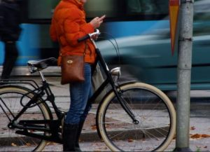 cell phone user and bike